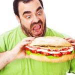 large-man-eating-huge-sandwich