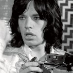 Mick Jagger with a Polaroid