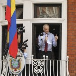 WikiLeaks founder Julian Assange gives the thumbs up sign after speaking to the media outside the Ecuador embassy in west Londo