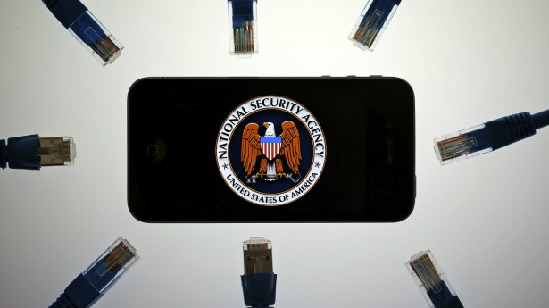 An-illustration-picture-shows-the-logo-of-the-U.S.-National-Security-Agency-on-the-display-of-an-iPhone-in-Berlin-June-7-2013.-REUTERS_Pawel-Kopczynski-615x345