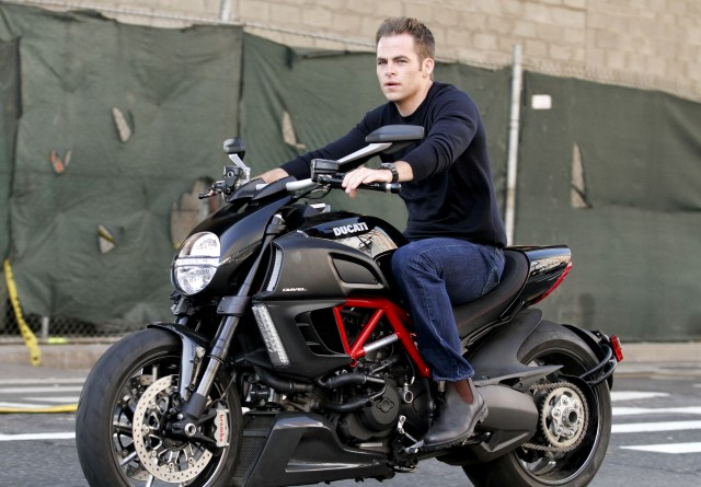 Chris Pine riding a Ducati motorcycle on the set of his new movie, 'Jack Ryan' in Manhattan