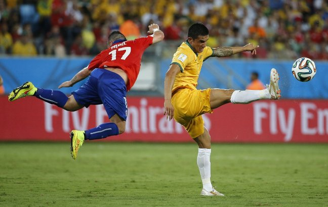 australias-tim-cahill-fights-for-the-ball-in-a-game-against-chile