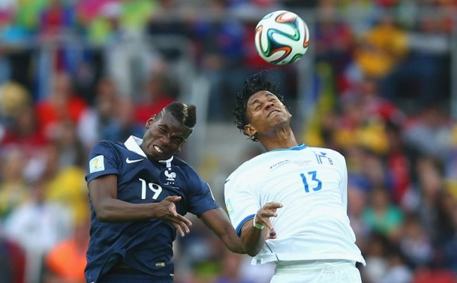 frances-paul-pogba-and-honduras-carlo-costly-jump-for-a-header