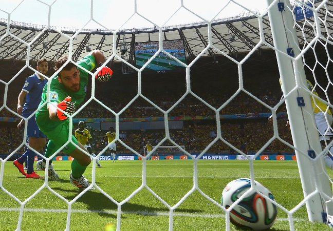 goalie-orestis-karnezis-of-greece-watches-a-shot-by-pablo-armero-of-colombia-go-into-his-net