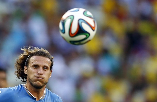 uruguays-diego-forlan-sees-the-ball-in-a-game-against-costa-rica