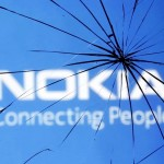 An illustration picture shows Nokia logo through a broken glass