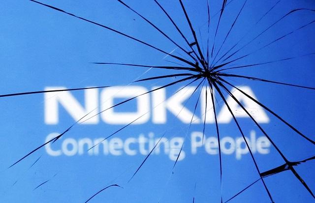 An illustration picture shows Nokia logo through a broken glass