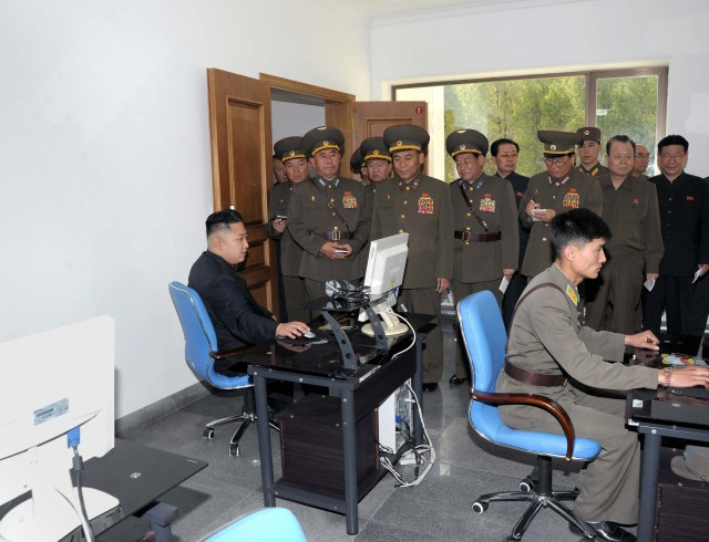 North Korean leader Kim looks at a computer screen as he visits Air and Anti-air Force Command of the Korean People's Army in this picture released by the North's official KCNA news agency in Pyongyang