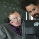 Hawking-with-his-assistant-Jonathan-Wood-1024x683