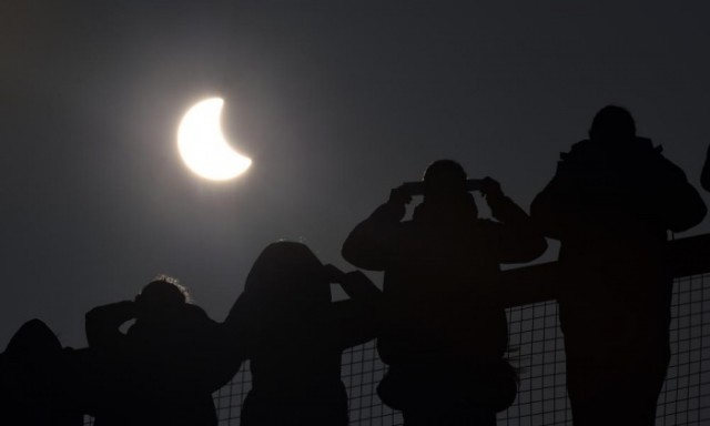 The eclipse begins over the Eden Project near St Austell, England