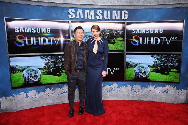HOLLYWOOD, CA - JUNE 09:  Actors B. D. Wong (L) and  Bryce Dallas Howard pose in front of Samsung's SUHD TVs at the premiere of Jurassic World at Dolby Theatre on June 9, 2015 in Hollywood, California.  (Photo by Jonathan Leibson/Getty Images for Samsung)