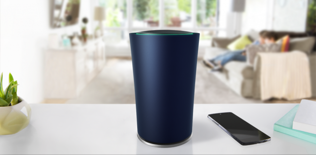 OnHub_on_counter_with_family_in_background.0