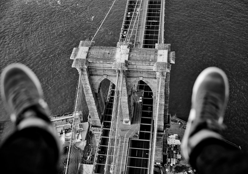 "PIC BY MATT HAWTHORNE / CATERS NEWS - (PICTURED: Brooklyn Bridge.) Forget selfies, belfies and dronies... One company is offering a variation of the popular snapshot - thousands of feet above the New York skyline. Aerial photography company FlyNYON are giving snappers the chance to take stomach-churning pictures of their limbs, hanging out of a helicopter above famous New York landmarks. The shot - known by the company as a ""shoe selfie"" - has become a huge hit, with legs being snapped over the likes of the Empire State Building, Central Park, Times Square and Freedom Tower. Thanks to the help of social media, FlyNYON, who are based in Kearney, NJ, have seen interest in the experience boom. SEE CATERS COPY"