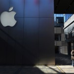 A man walks past an Apple store in Beijing on February 18, 2016. Apple on February 18 launched its mobile payments service Apple Pay in China, pitting the US technology giant against strong domestic players in an already crowded field. AFP PHOTO / GREG BAKER / AFP / GREG BAKER        (Photo credit should read GREG BAKER/AFP/Getty Images)