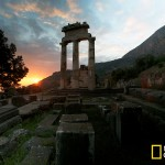 DELPHI, GREECE - Sun sets behind the Temple of Athena at Delphi. 