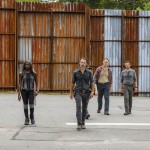 Alanna Masterson as Tara Chambler, Danai Gurira as Michonne, Andrew Lincoln as Rick Grimes, Chandler Riggs as Carl Grimes, Jason Douglas as Tobin, Ross Marquand as Aaron, Christian Serratos as Rosita Espinosa,  - The Walking Dead _ Season 7, Episode 9 - Photo Credit: Gene Page/AMC