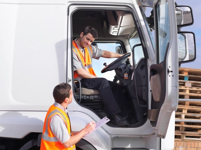 Truck driver and dispatch worker talk